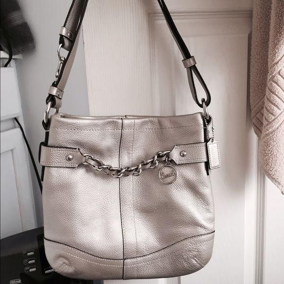 704e950927 Authentic Coach bag never used silver leather With beautiful pale pink  Lining you can tell this