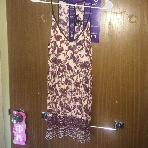 """Forever 21 patterned dress with open back I'm 5""""8 and it's too short on me! Flowy with a really cool back! Forever 21 Dresses Mini"""