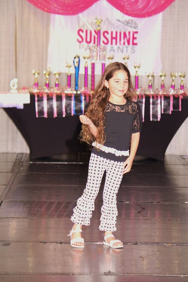 Penelope Moonlight dots triple ruffle pants and black lace top. $36.00 each Buy it at  www.stylishbabeboutique.com #instaboutique #kidsfashionshow #rufflebottompants #stylishbabeboutique #pageantwear #littlegirlspageants #littlegirlsclothingboutique