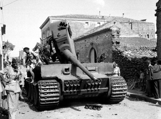 Slaughter is the best medicine   A Tiger tank destroyed in Belpasso Sicily.the summer of 1943.Judging by the shiny threaded barrel - muzzle brake twisted the British for a souvenir…