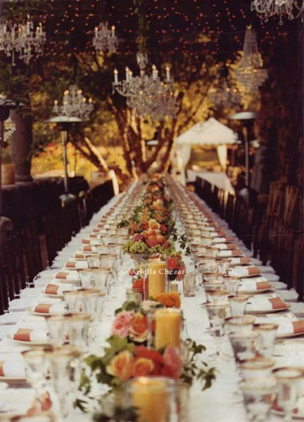 chandeliers in the trees over a wedding feast.  ariellaflowers.com