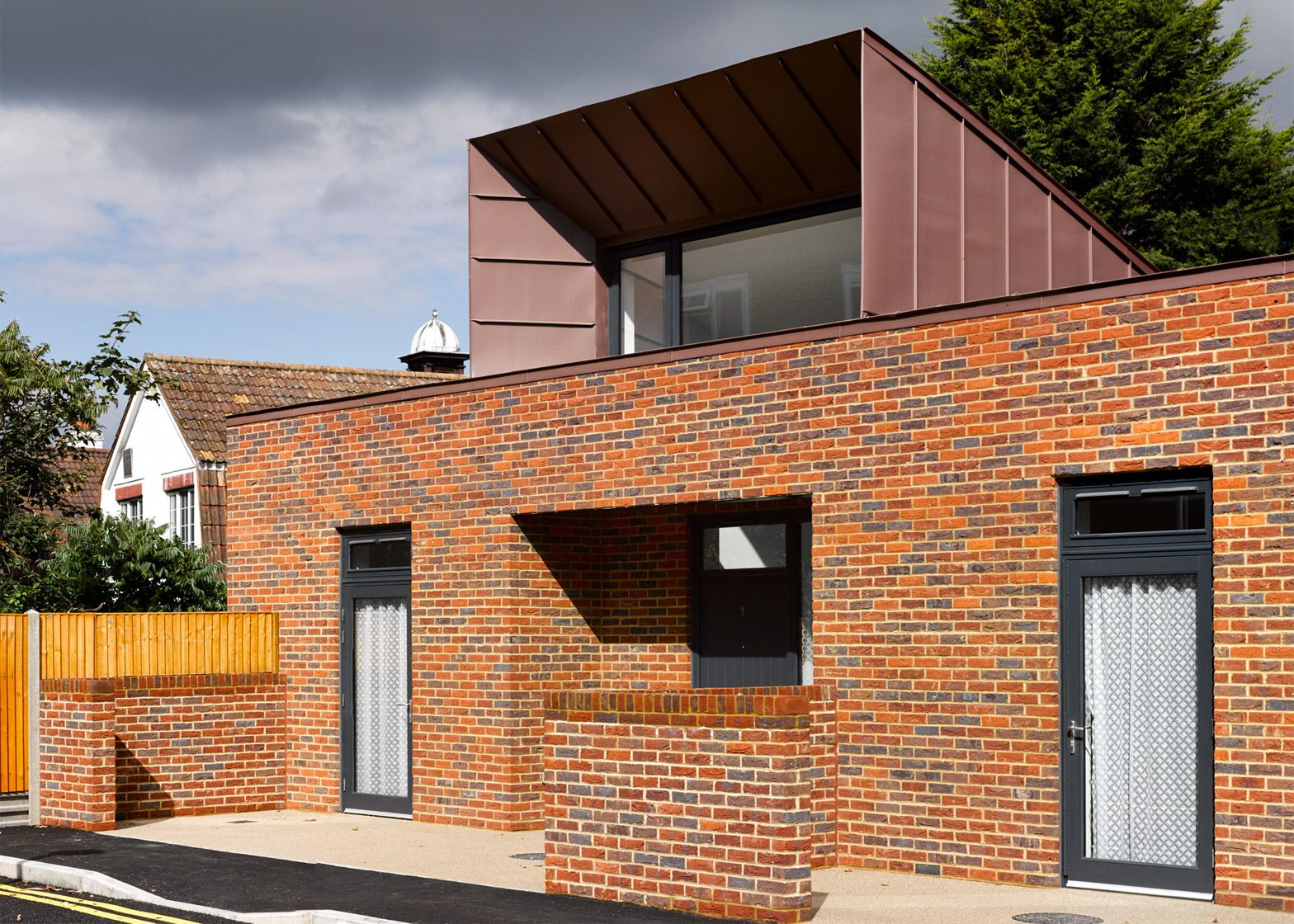 Ravens Way Housing By Bell Phillips Architects Roof Cost Architecture House Brick