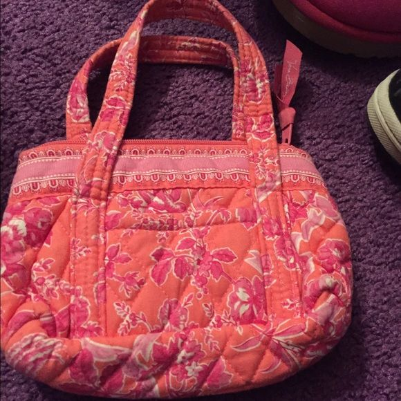 I stopped using these bags and phone holders. There are four different Vera Bradley items. One handbag medium sized (pink and orange), another small handbag (pink and orange), and two phone holders (multicolor and floral). Vera Bradley Bags Totes