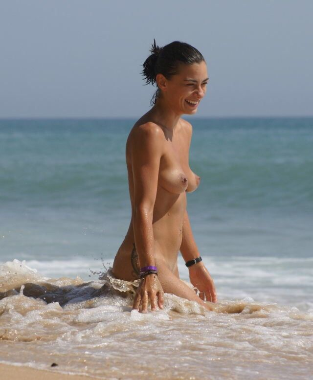 Beach nude girl happy