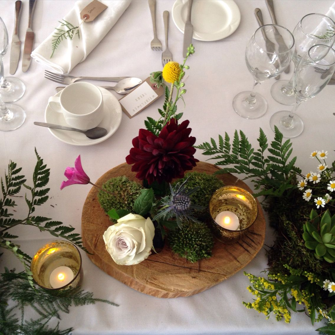 Log slices and flowers by Waterbaby Flowers