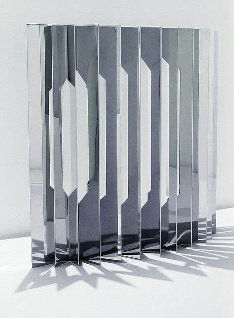 Screen by New York City based designers Aranda / Lasch, mirror polish stainless steel