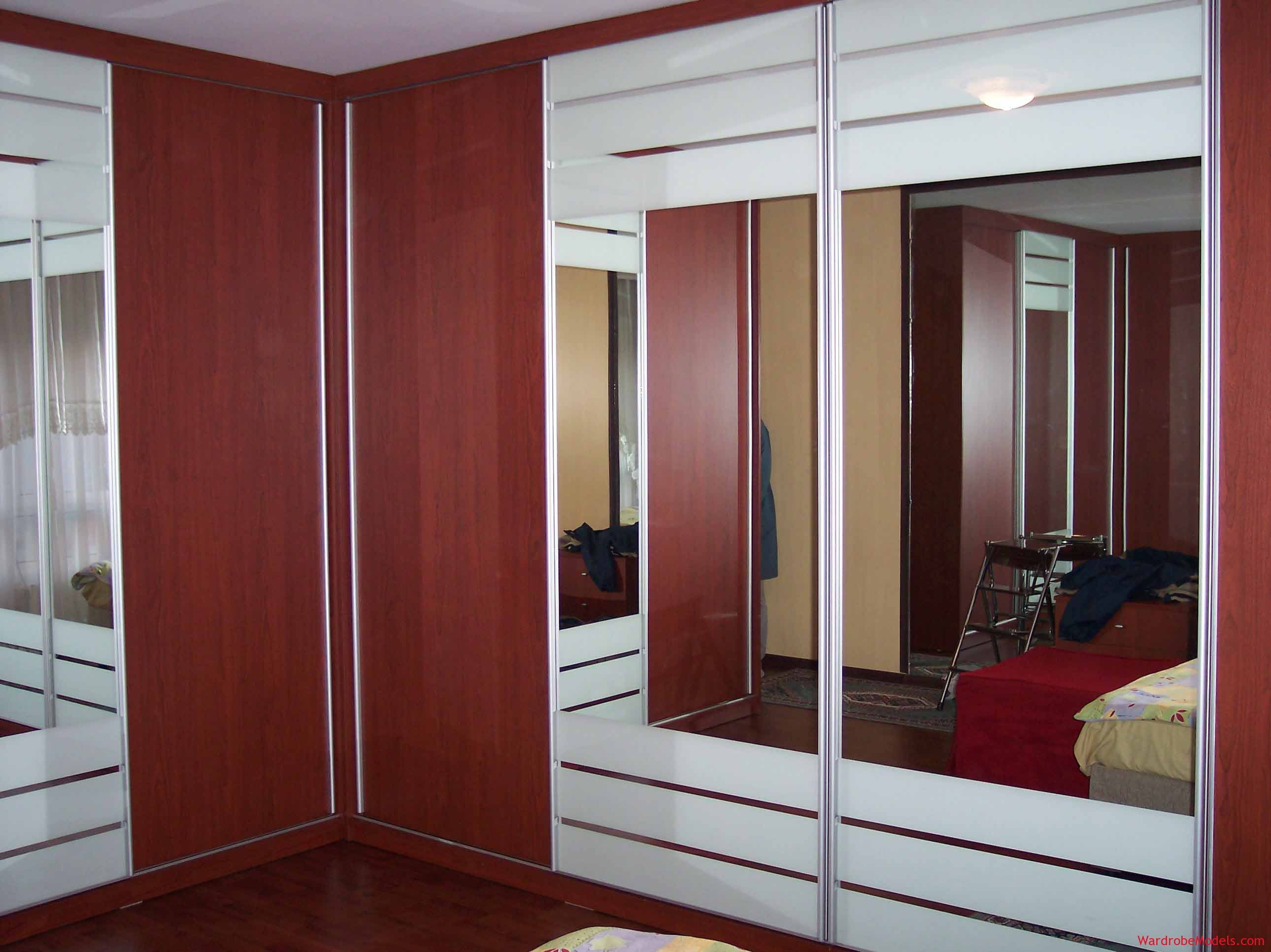 Bedroom wardrobe designs - Bedroom Exciting White Mirrored Frames Doors Wardrobe Design With Wooden Panels Combination As Inspiring Clothes Cabinetry In Master Bedroom Decors Perfect