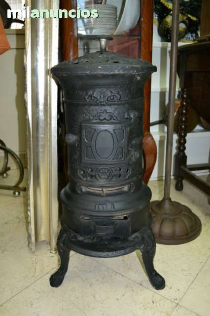 Estufa hierro antigua foto 1 estufas de le a de carbon for Estufa lena calefaccion radiadores
