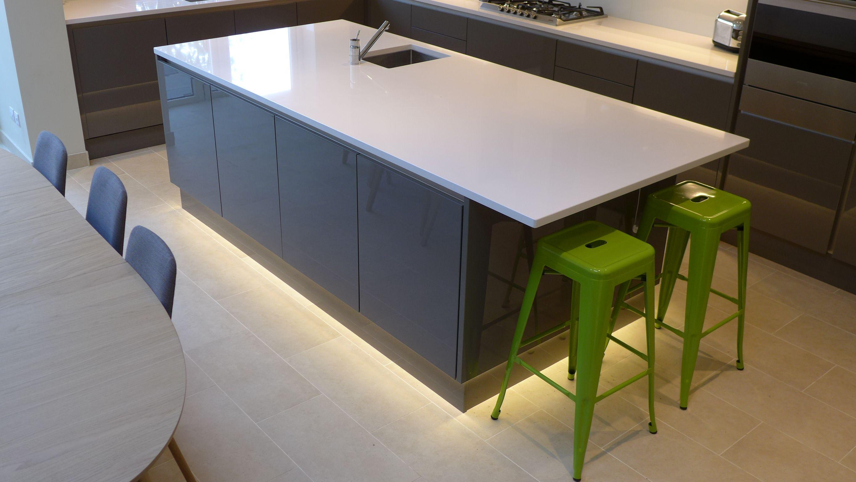 LED Plinth Light Around Base Of Gloss Grey Kitchen Island With - Kitchen plinth lights white