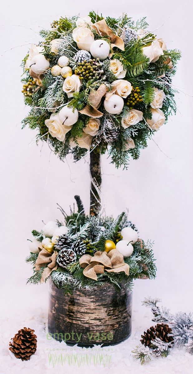Holiday Rose Tree This captivating holiday arrangement is