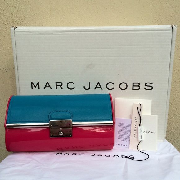"Marc Jacobs Pink & Turquoise Plexi Clutch Resin and leather two-tone clutch with antiqued silver hardware, pushlock closure, and a leather lined interior. 8.5""W x 5""H x 3""D. New with tags, card, dust bag, and box, which has some shelf storage wear on it. The 'tarnished' spots on the opening aren't wear and were present at purchase. Officially, the color is red, but it is pink. See other listing for more photos. ✅ OFFERS ✨ SHIPS WITHIN 1 BUSINESS DAY TRADES Marc Jacobs Bags"