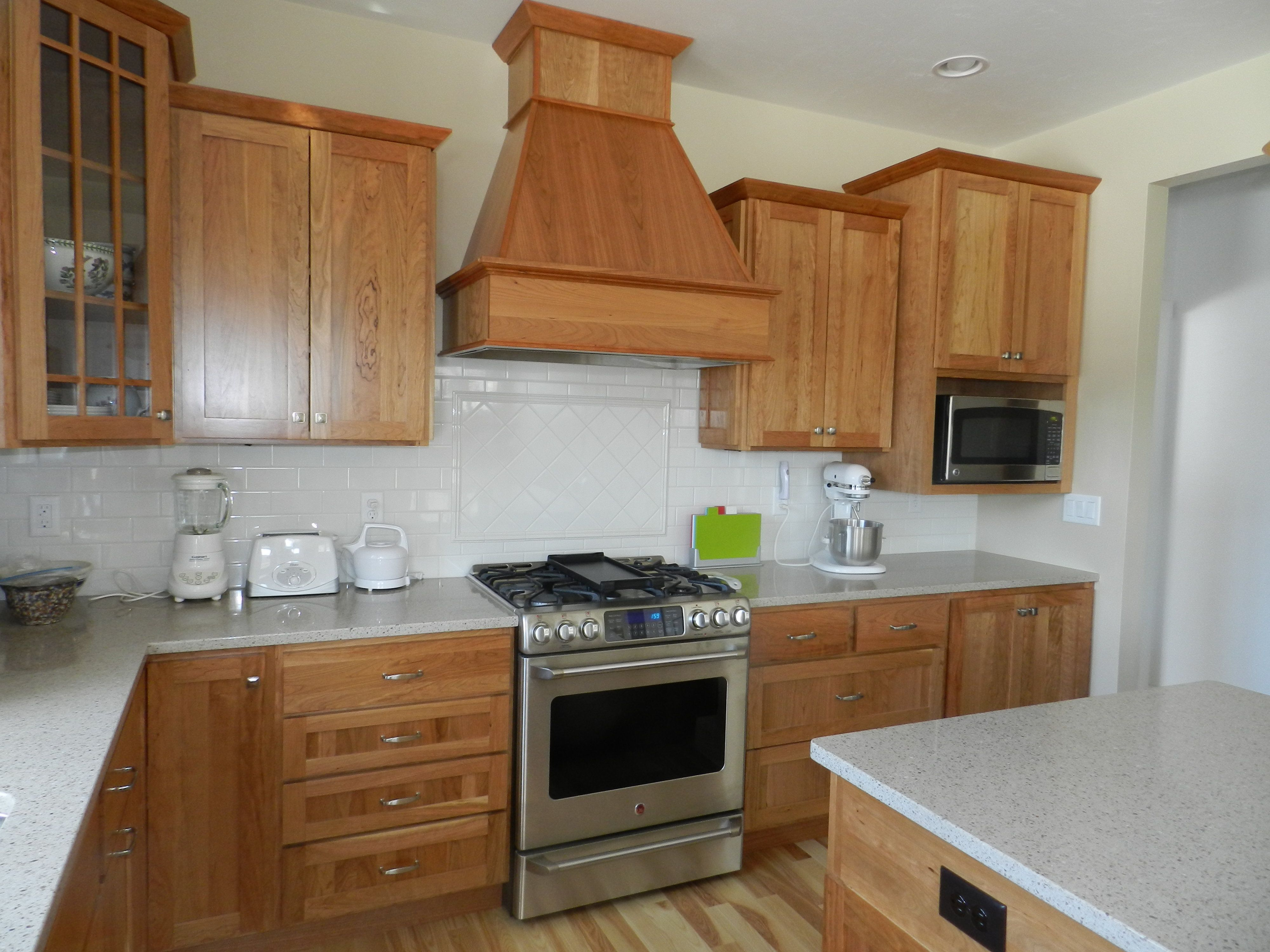 Great Northern Cabinetry, Wood Species: Cherry, Stain: Natural, Door Style:  Shakertown IV, Zodiaq Countertops