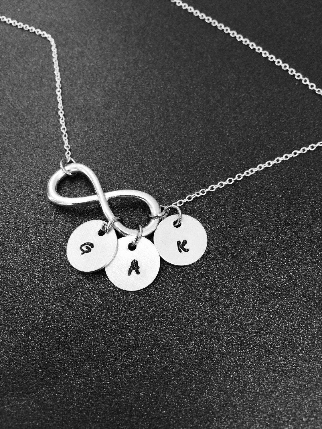 A personal favorite from my Etsy shop https://www.etsy.com/listing/221060581/infinity-with-initial-necklace-infinity