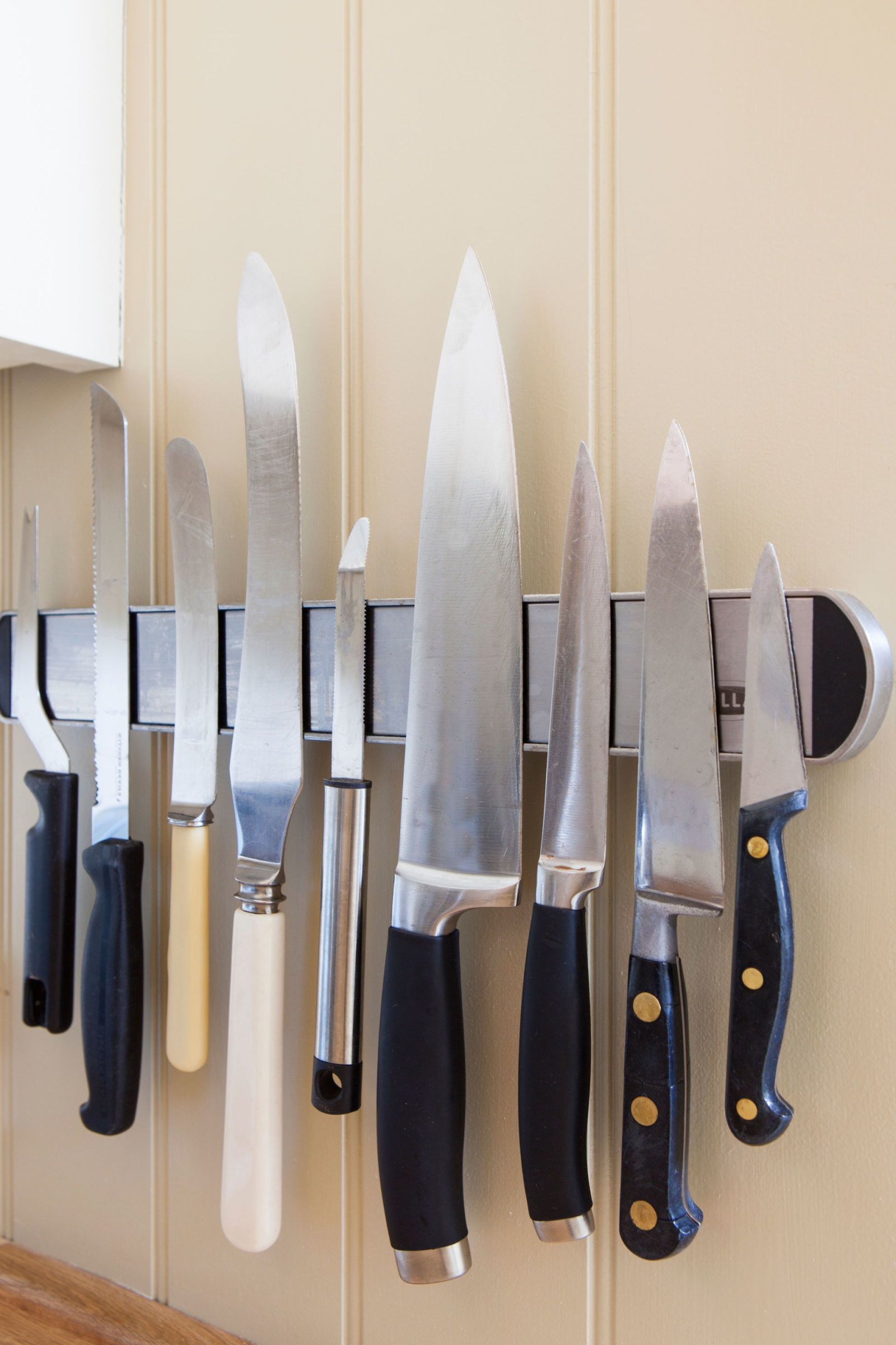 Swap out a clunky, space-hogging knife block for a sleek wall-mountable magnetic strip that keeps your knives clean and far away from tiny, curious hands.   - Redbook.com