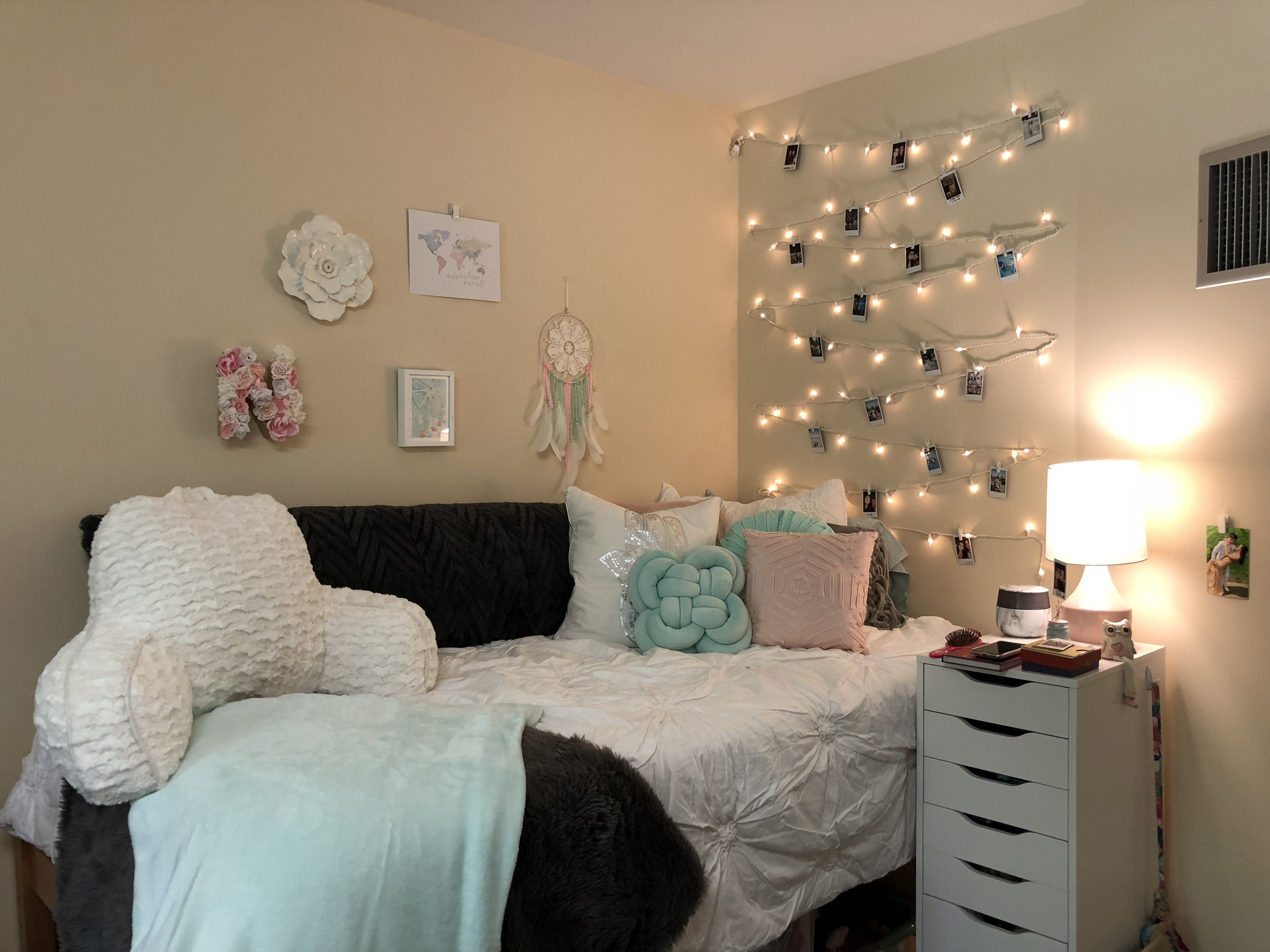 Pink, mint, white, and gray color themed dorm room