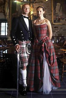 4bb8a912ee2 A traditional Scottish wedding dress features tartan in ribbons