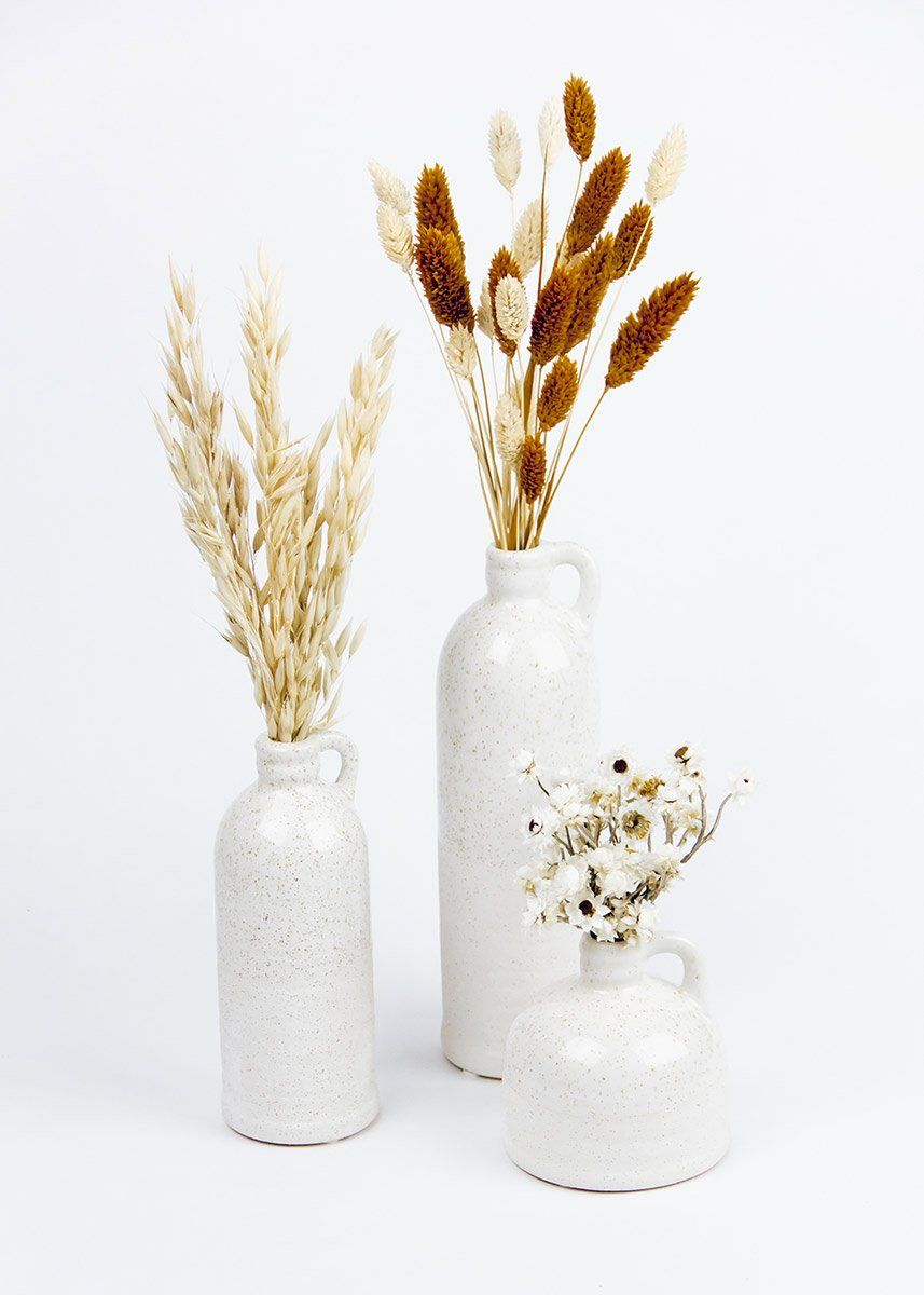 Start your season off right with beautiful stoneware jugs, easy to style florals and greenery and use throughout your home. This vase offers an updated modern version of the classic country wear vases of the past.  White  9.75