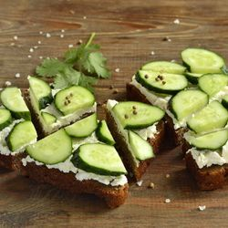 """Cucumber sandwiches!!    Top party rye with cream cheese and a slice of cucumber, and let the little appetizers work their magic!"""