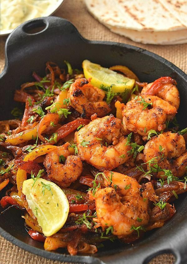 #saucesavorybitesrecipes #shrimpfajitasrecipe #easyshrimpfajitas #seasoningcayenne #shrimprecipes #texmexrecipes #fajitasrecipe #shrimpfajitas #dinnerrecipes #tortillataco #peppersonion #deliciously #mexicanfood #easyrecipe #wrappedSkillet Shrimp Fajitas recipe - very deliciously spicy shrimp cooked with bell peppers,onion cooked in cajun seasoning,cayenne pepper and some more served wrapped in a tortilla/taco shell with sour cream sauce.#savorybitesrecipes #shrimpfajitas