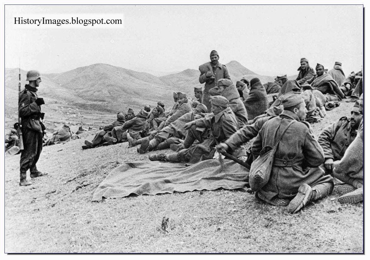 Greek Soldiers Taken Prisoner Sit Around As A German Guard Watches Over Them May June 1941 Mussolini Attacked The Deyteros Pagkosmios Polemos Iii