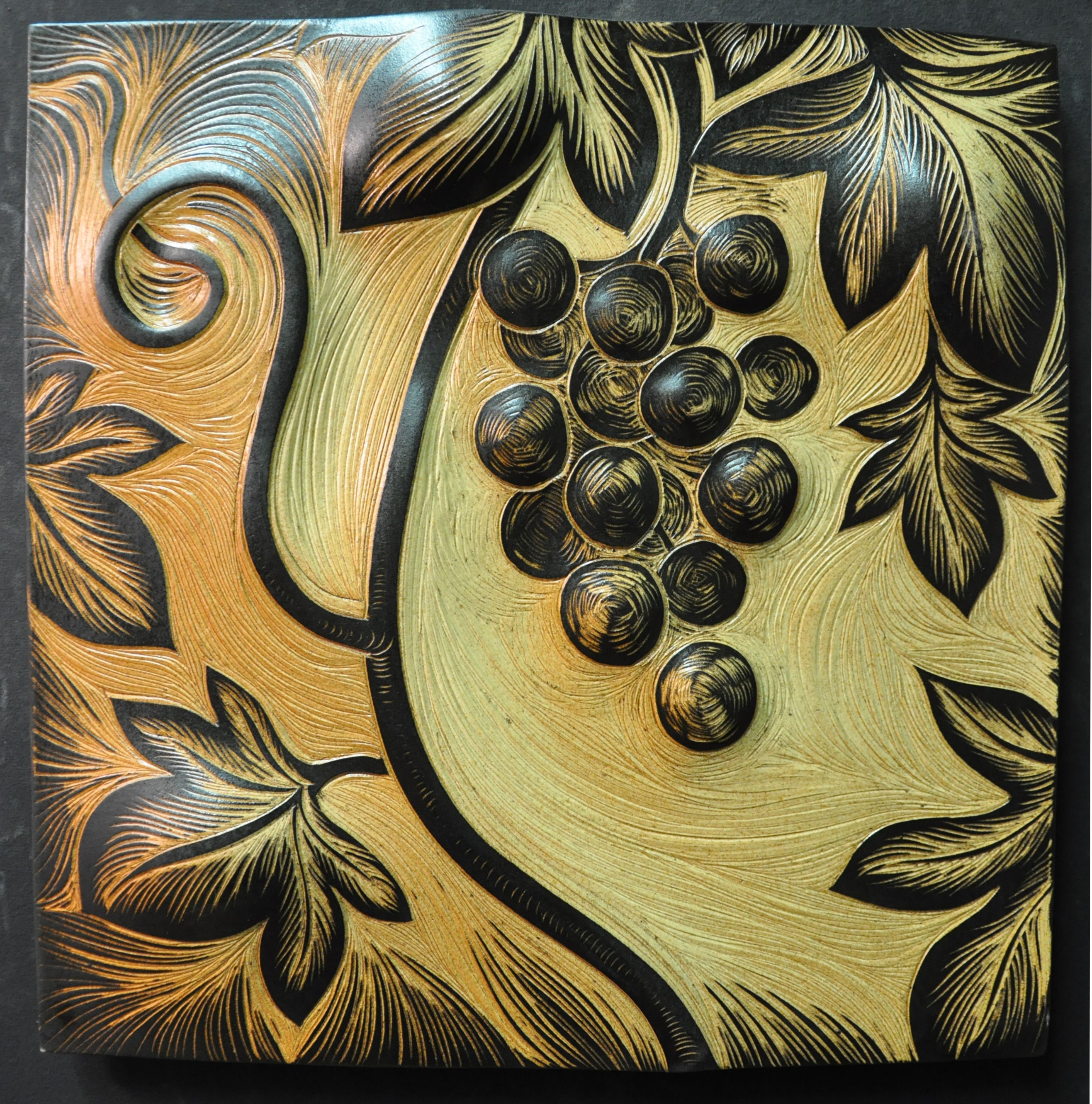 Detail of handmade, sgraffito-carved, ceramic wall tile by Natalie ...