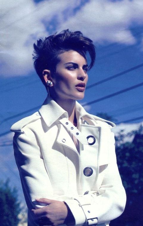 Marie Claire, March 2014 (France): Ferragamo women's SS14 runway collection white cotton trench coat.
