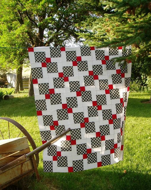 Lavender Quilts...I love the simple look of the black, red and white.