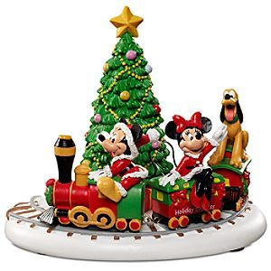 Department 56 Mickey's Village Mickey's Holiday Express Collectible Figurine at ShoppingNexus.com All aboard! Mickey, Minnie and Pluto ride the Holiday Express choo-choo train all the way to Christmas in this adorable Mickey's Village figurine by Department 56.
