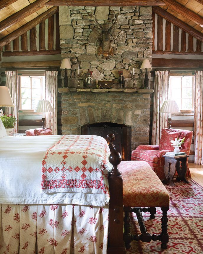 What a great bedroom! Love the rockwork fireplace and the antique