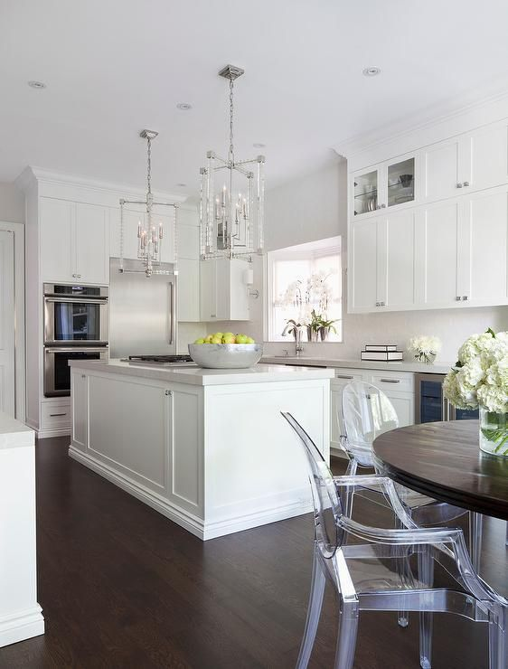 Two Hudson Valley Lighting Alpine Pendants Hang Over A White Kitchen Island  Topped With A Light