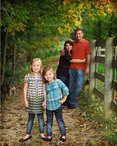 Family Outside W Fence Outdoor Family Portraits Family Portrait Poses Fall Family Portraits