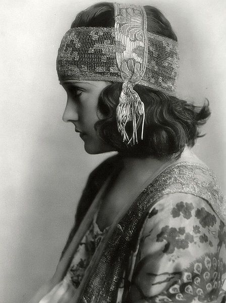 In a production still from the 1919 film Don't Change Your Husband, actress Gloria Swanson is shown in profile. Swanson was one of the most prominent actors during the silent film era and was often directed by the famous Cecil B. DeMille. She was also nominated for the first Academy Award in the Best Actress category but lost to Janet Gaynor. Beyond acting, she was also considered a fashion icon around the world.