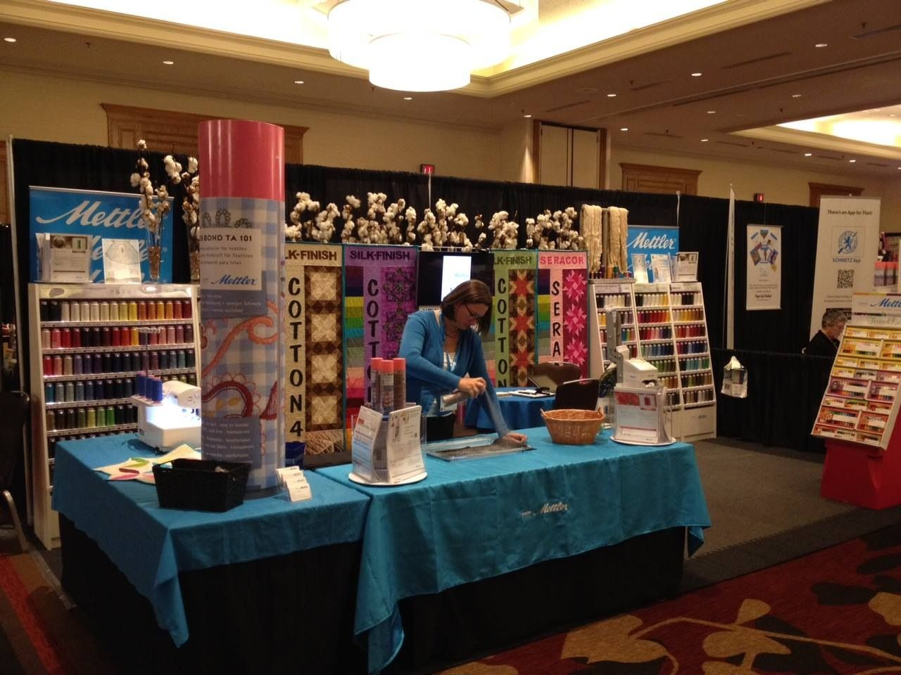 This was the reason I own a Cameo cutting machine. I was contracted by Mettler threads to make backdrops for their tradeshow booth. This picture shows only 4 of the 16 2'x6′ quilts I made to put on grid wall to show the new colors of the new cones. When we designed the quilts using … Continue reading Mettler Thread Trade Show Booth Backdrops →