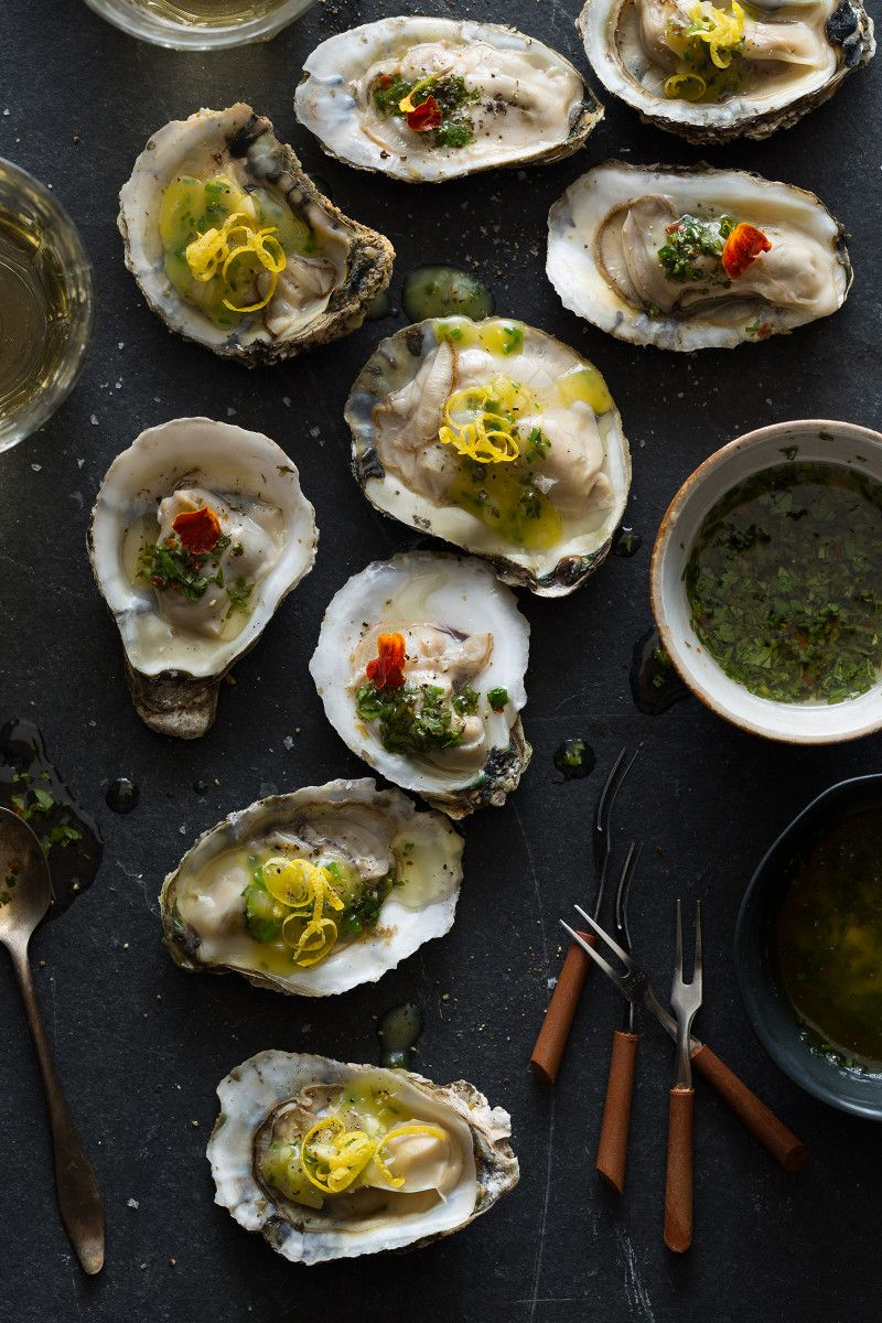 A recipe for Roasted Oysters with a compound butter and a chimichurri sauce.