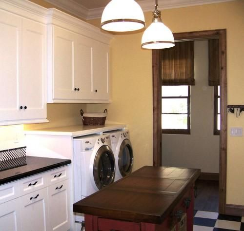 Suzie: Design Moe - Sunny white & yellow laundry room with white cabinets, black counter tops, ...