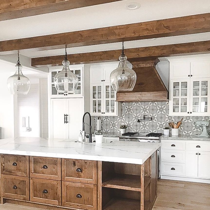 White kitchen with natural wood center islandcement tile