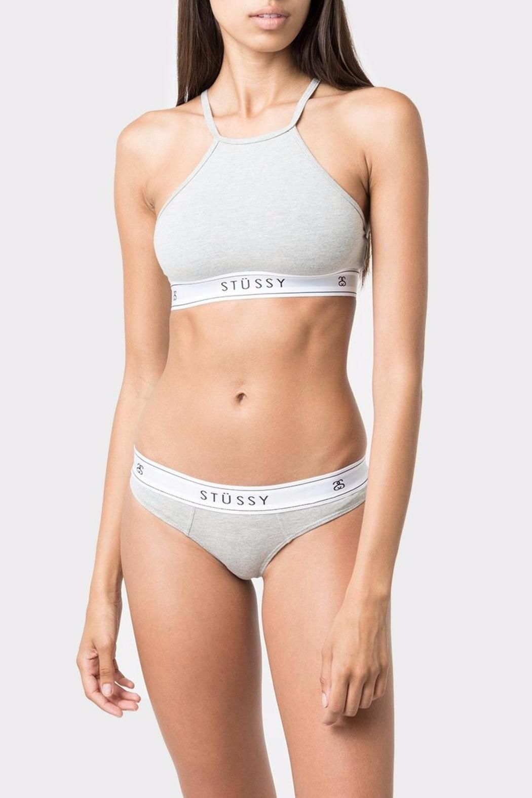 """Overhead high neck fit Branded thick elastic band Stretch comfort fit Moderate coverage MODEL:  Height: 5'9""""  Weight: 120lbs  Shown Wearing: XS High Neck Crop by Stussy Women. Clothing - Activewear - Sports Bras Tel Aviv Israel"""