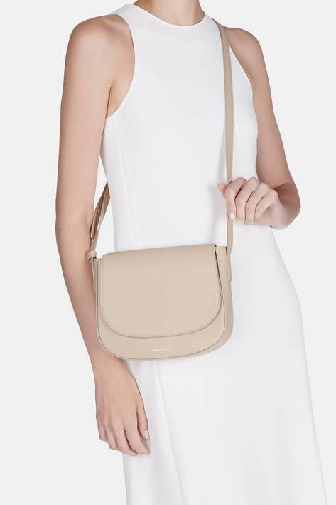 BACK IN STOCK  Combining the smooth curves of a saddlebag with the ease of  hands-free carrying, this crossbody style has an understated elegance that  is ... 02ba209c1e
