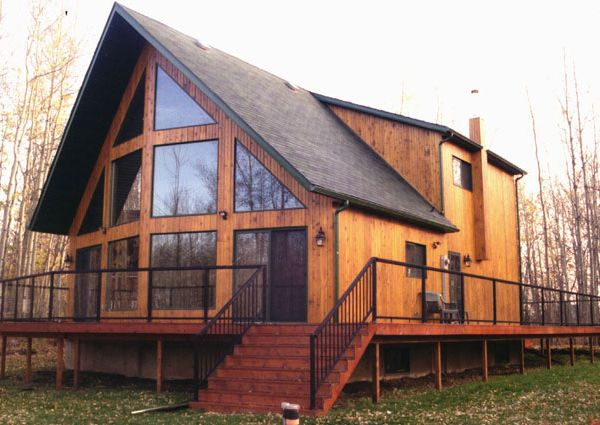Wouldn't you love to live in this prestigious ever-so-grand cabin with large windows surrounded by a long railing for a clean, crisp look.