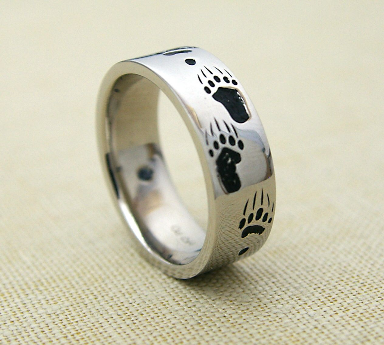 Custom men's wedding band with engraved bear tracks. (With
