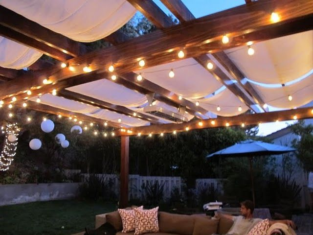 "The ""pergola"" draped with fabric and lights- LOVE IT ..."