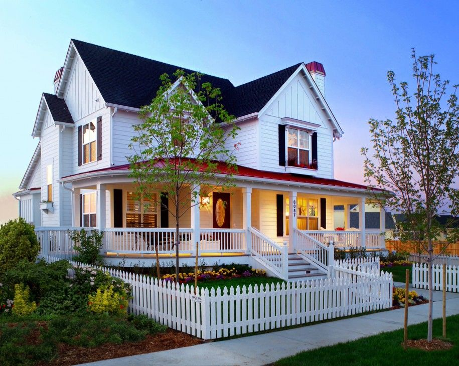 Exterior Gable Metal Roof And White Porch Railing Plus Wood Siding In Farmhouse Design