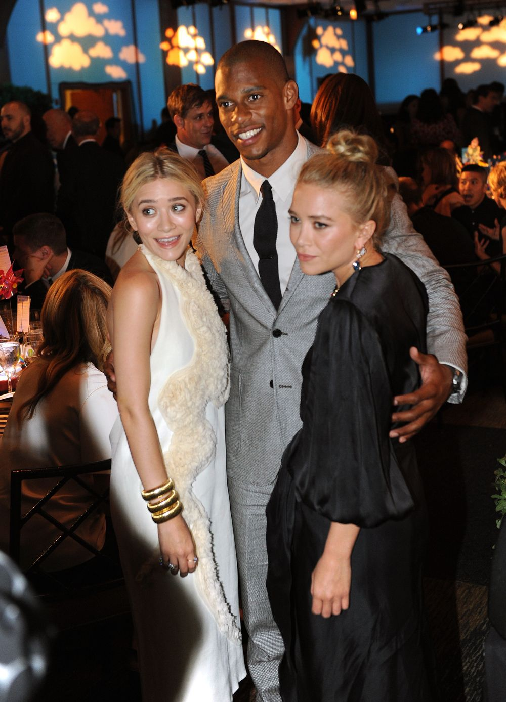 Honorees Victor Cruz and Mary Kate & Ashley Olsen at The