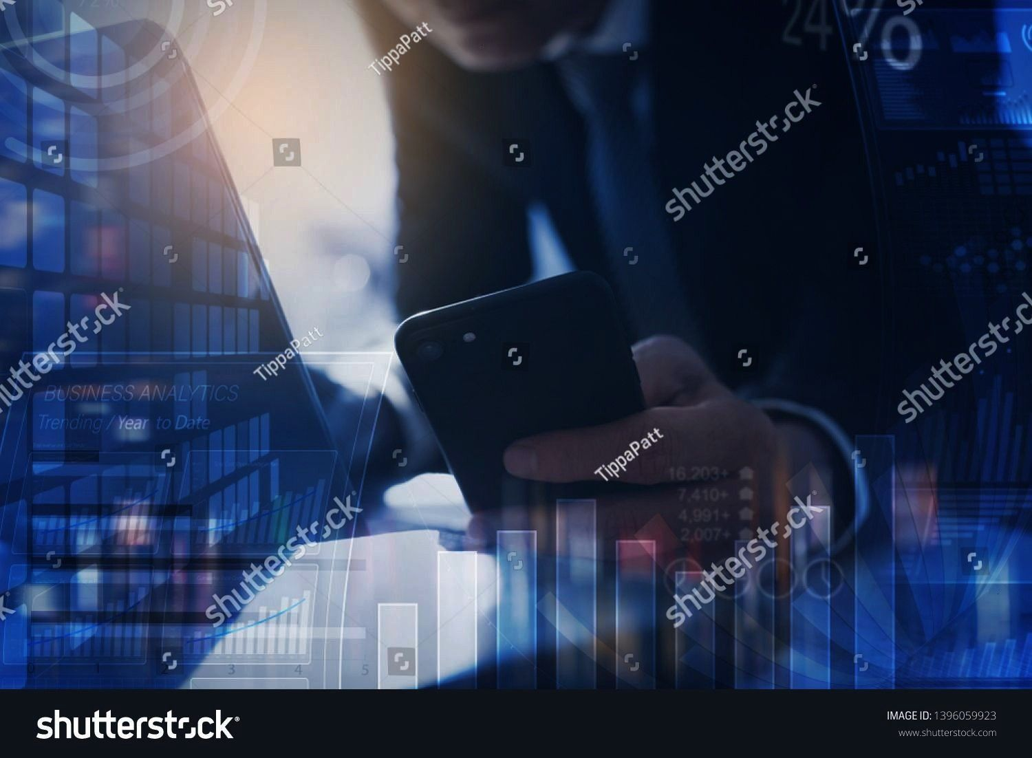 concept digital diagram graph interface Businessman finance analyst working in office Man using smartphone laptop with financial data modern dashboard computer interface...