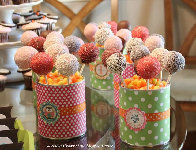 covered cans filled with candy corn and cake pops
