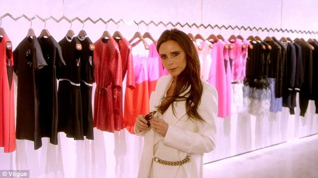 During the interview Victoria led the Vogue team around her Mayfair store wearing a chic white coat