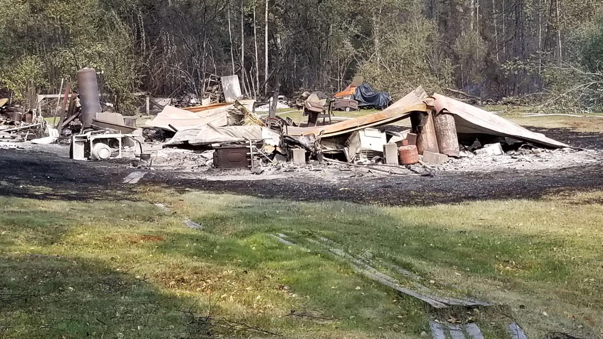 Burned cars in the subdivision off the Parks Highway by