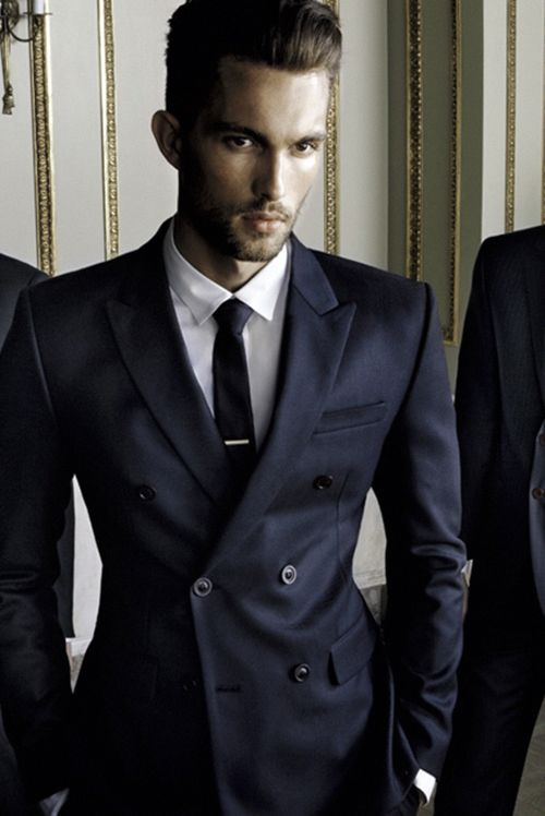It's all about tailoring in a double breasted suit for a modern ...