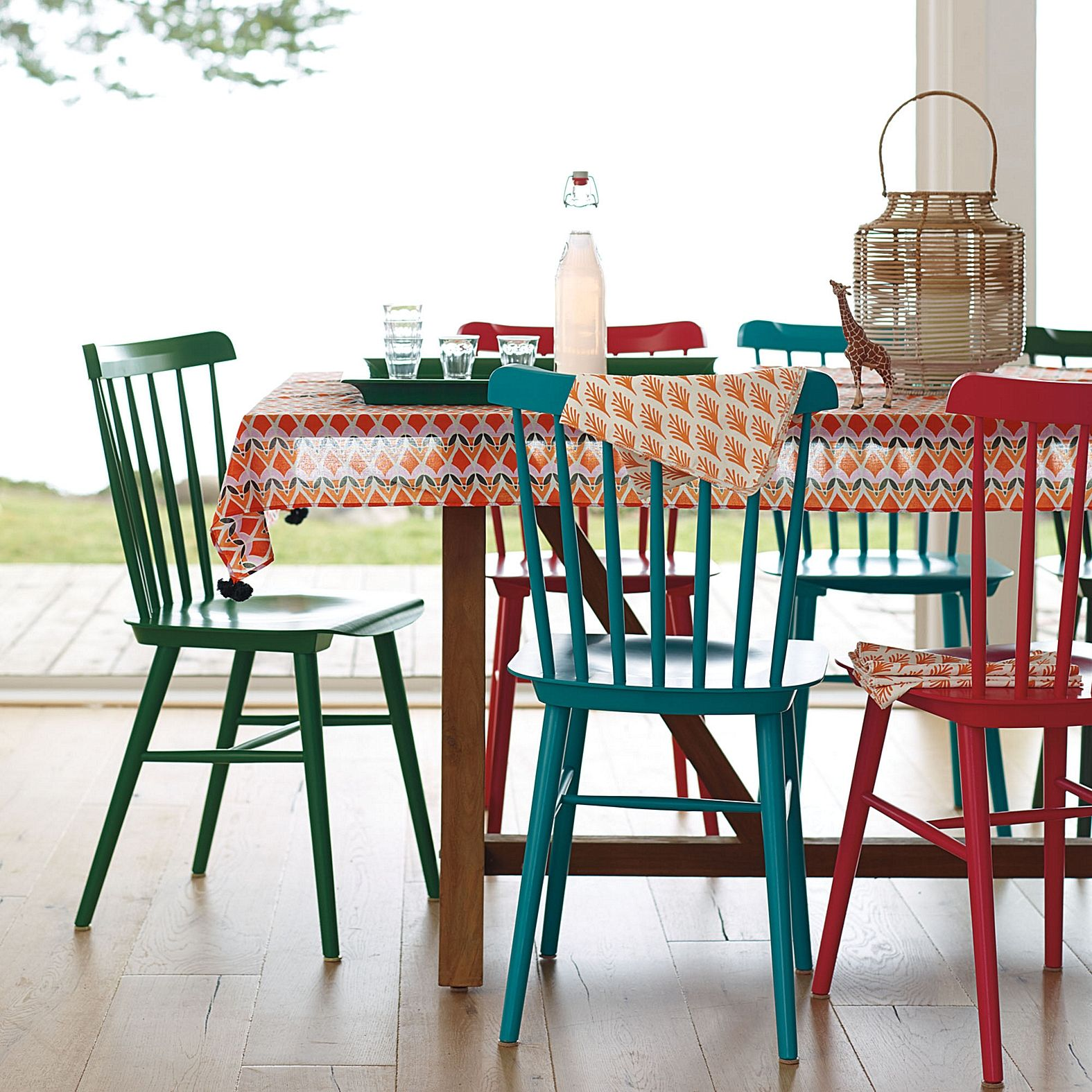 Like the idea of these tucker chairs in different colors for Different color chairs