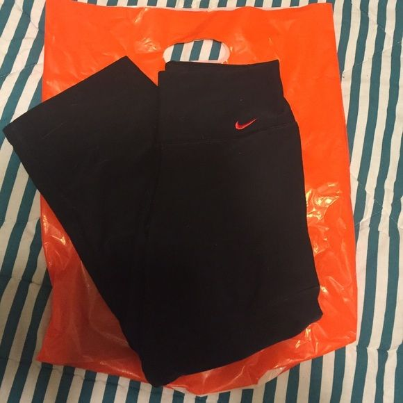 Nike Dri-fit capris Adorable extra small Nike capris. They are tight fit but kinda loose around the legs. They have a pink Nike sign and a pink stripe on the back which is in the last picture. These were never worn but washed a few times Nike Pants Capris